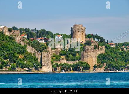 Rumelihisari (Rumeli Fortress) as seen from a ship cruise in Bosphorous. Istanbul, Turkey. - Stock Photo