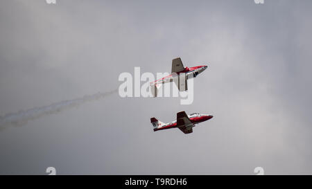 Royal Canadian Air Force CT-114 Tutors with the Canadian Forces Snowbirds 431st Air Demonstration Squadron, perform aerial maneuvers during the Defenders of Liberty Air & Space Show at Barksdale Air Force Base, La., May 18, 2019. Serving as ambassadors of the CAF, the CF Snowbirds demonstrate a high level of skill, professionalism, teamwork, discipline and dedication inherent in the men and women of the CAF. (U.S. Air Force photo by Airman 1st Class Lillian Miller) - Stock Photo