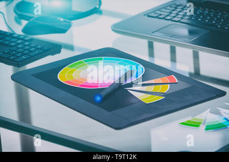 Designer tools used in office graphics tablet color wheel and computers - Stock Photo