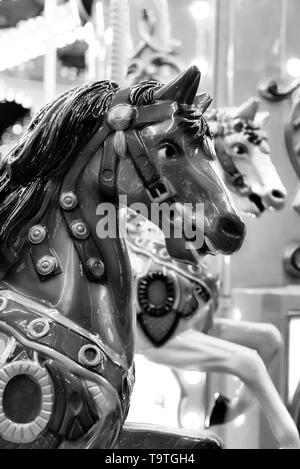 carousel horse in black and white with bokeh - Stock Photo