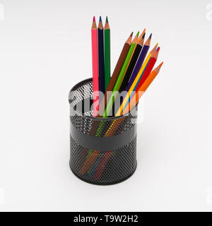 set of colored pencils in a basket on a white background, isolated. back to school - Stock Photo