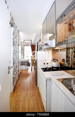 Kitchen set at small apartement, studio type - Stock Photo