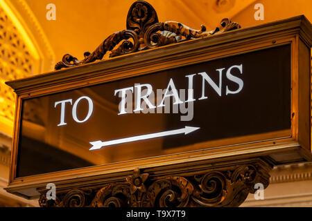 A decorative sign directing passengers to train platforms inside Chicago Union Station, Illinois, USA. - Stock Photo