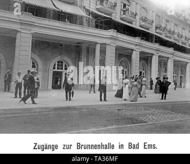 Holiday guests in front of the Brunnenhalle in Bad Ems. - Stock Photo