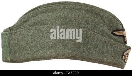 A garrison cap for enlisted men/NCOs of the Waffen-SS depot piece Field-grey woollen cloth in SS 'boat-shaped' cut with stitched-in cap piping in base cloth, brown imitation silk liner. The cap was enlarged with a reverse cloth insert. Woven BeVo insignia. historic, historical, 20th century, 1930s, 1940s, Waffen-SS, armed division of the SS, armed service, armed services, NS, National Socialism, Nazism, Third Reich, German Reich, Germany, military, militaria, utensil, piece of equipment, utensils, object, objects, stills, clipping, clippings, cut out, cut-out, cut-outs, fas, Editorial-Use-Only - Stock Photo