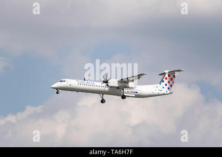 Munich, Germany - May 02. 2019 : Croatia Airlines De Havilland Canada DHC-8-402Q Dash 8 with the aircraft registration 9A-CQB in the approach to the s - Stock Photo