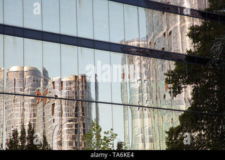 Reflection of some of the tall buildings in the commercial district and centre of Perth, Western Australia on an afternoon in May. - Stock Photo