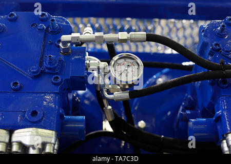 Close up view of air compressor with pressure gauge. Selective focus. - Stock Photo