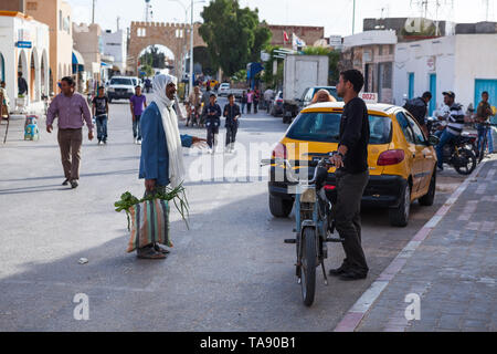 SOUSSE, TUNISIA, AFRICA-CIRCA MAY, 2012: Local Arabian people talk together in small town on the street. Backstreets of Sousse city with everyday life - Stock Photo