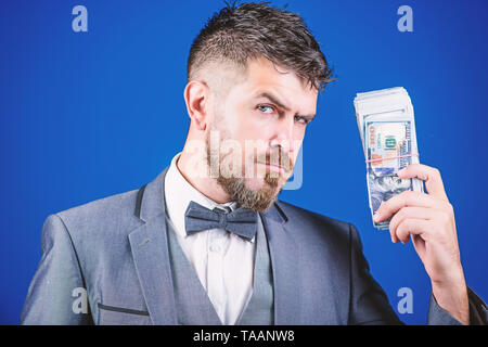 Serious about money. Making money with his own business. Bearded man holding cash money. Rich businessman with us dollars banknotes. Currency broker with bundle of money. Business startup loan. - Stock Photo