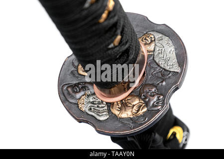 Devil Tsuba : handguard of Japanese sword made of copper isolated in white background. - Stock Photo