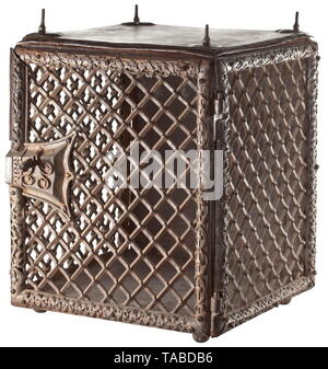 A South German/Italian wrought iron Gothic cage, circa 1500 Heavy frame construction, the cornices with perforate iron tendril ornamentation (two are undecorated), three sides metal-grilled, the reverse, base and upper side panelled, ball feet at the base, the upper side with a massive screw thread over heart-shaped spacers, elaborately decorated Gothic lock with a richly perforate Venetian key. Dimensions 73 x 53 x 53 cm. Heavy type for a wall column. Impressive Gothic workmanship. historic, historical, handicrafts, handcraft, craft, object, obj, Additional-Rights-Clearance-Info-Not-Available - Stock Photo