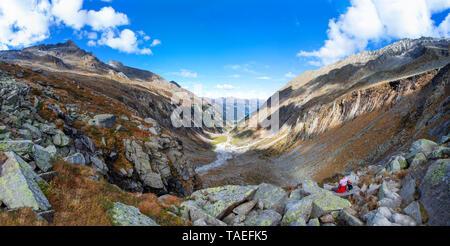 Austria, Salzburg State, High Tauern National Park, Zillertal Alps, woman having a break on a hiking trip - Stock Photo