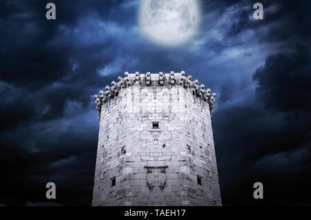Tower of castle at night in the moonlight. - Stock Photo