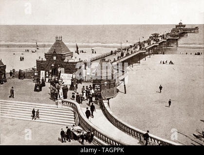 A late 19th Century view of Skegness pier opened on Whit Monday in June 1881 by the Duke of Edinburgh Alfred, Duke of Saxe-Coburg and Gotha and was at the time the fourth longest in England, at a length of 614 yards (561 m) long. Skegness is a seaside town  on the Lincolnshire coast of the North Sea, England, - Stock Photo