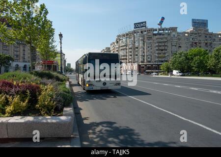 Single decker public STB bus on the south-east corner of Piața Unirii (Union Square / Unification Square)  in central Bucharest/ București,  Romania - Stock Photo