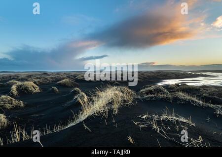 Stokksnes cape and Vestrahorn Mountain during sunset. Eastern Iceland landscape. - Stock Photo