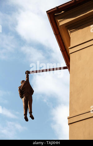Man Hanging Out by David Cerny in Prague - Stock Photo