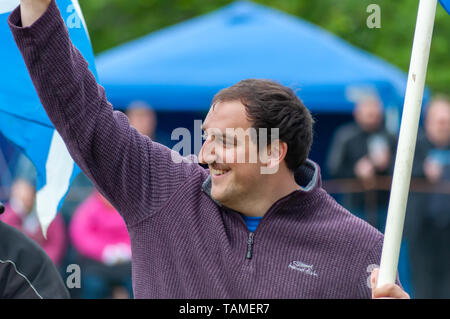Glasgow, Scotland, UK. 26th May, 2019. An athlete competing in the Carmunnock International Highland Games which celebrates traditional Scottish culture and is held at King George V Playing Fields in the picturesque conservation village of Carmunnock. Credit: Skully/Alamy Live News - Stock Photo