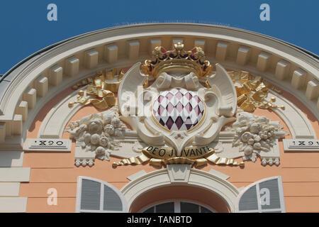 Monte Carlo, Monaco - Apr 19, 2019: State Emblem on building facade - Stock Photo