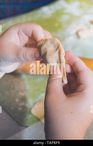 Raw and fresh is stuck on the dumplings are on the Board - Stock Photo