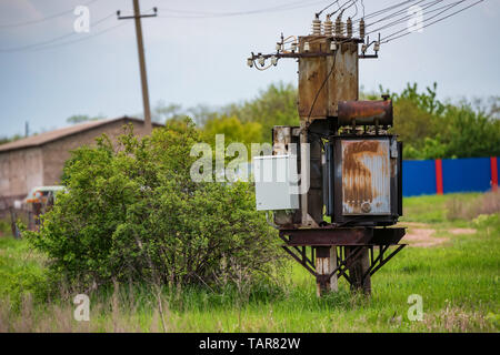 Old rusty electrical control unit outside in coutryside - Stock Photo