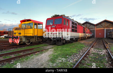 Two trains in depot at a day - Stock Photo