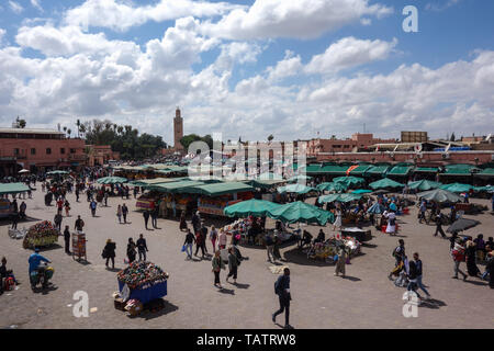 Marrakesh, Morocco - March 31st, 2019: Jamaa el Fna (also Jemaa el-Fnaa, Djema el-Fna or Djemaa el-Fnaa) during daytime - Stock Photo