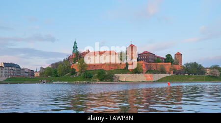 Panoramic view of Wawel castle on a sunset, from across the river Vistula - Stock Photo