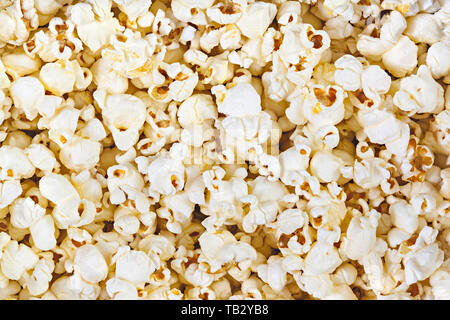 Full frame top view of popcorn background. - Stock Photo