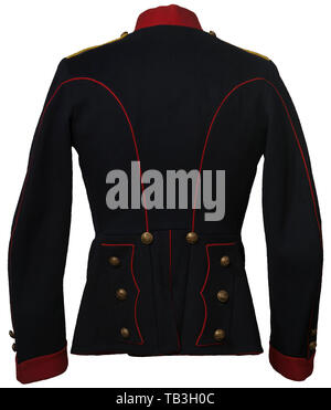 An English enlisted lancer's uniform for an individual in the 12th Lancer Regiment, Tunic of black cotton material with red piping on arms and back, red cotton collar with regimental insignia, yellow cord sewn in shoulder boards with 12th lancer buttons, gold regimental buttons, red parade rabatte, white cotton lining in tunic and black silk collar lining. 1914 dated. USA-lot. historic, historical 20th century, Additional-Rights-Clearance-Info-Not-Available - Stock Photo