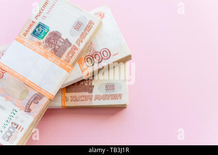 Stack of 5000 rubles packs isolated on pink. The concept of wealth, profits, business and finance. Stack money in the five thousandth bills banknotes - Stock Photo