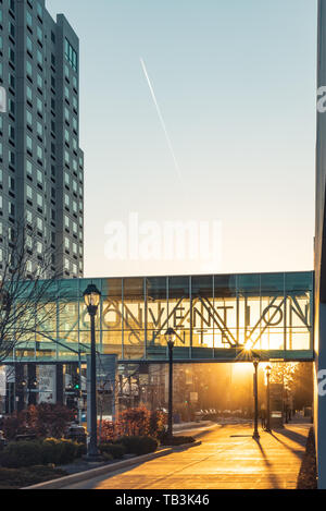 Early Evening Views of the Sun Setting under the Convention Center Skybridge in Downtown Spokane Washington USA - Stock Photo