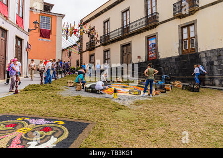 2016/06/15, La Orotava, Spain. During the celebration, carpets made of flower blossoms and salt with various motifs are made on the streets of the cit - Stock Photo
