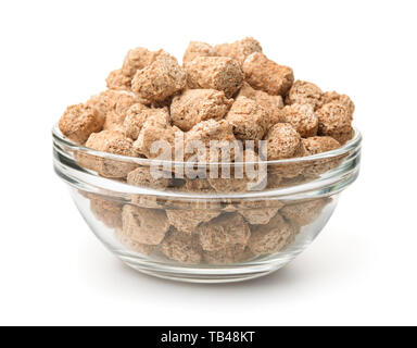 Glass bowl of extruded oats bran pellets isolated on white - Stock Photo