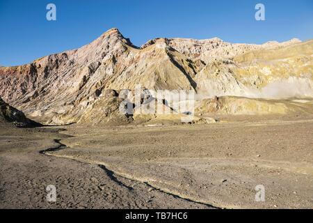 Rock formations with fumarole on the volcanic island White Island, Whakaari, Bay of Plenty, North Island, New Zealand - Stock Photo