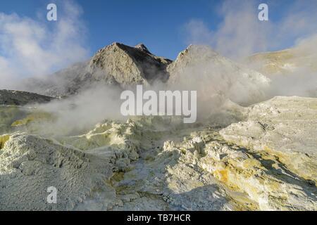 Yellow sulphur and fumarole on the volcanic island of White Island, Whakaari, Bay of Plenty, North Island, New Zealand - Stock Photo