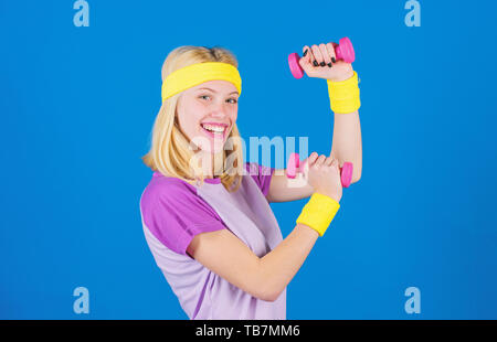 Ultimate upper body workout for women. Fitness instructor hold little dumbbell blue background. Fitness concept. Girl exercising with dumbbell. Workout with dumbbell. Beginner dumbbell exercises. - Stock Photo