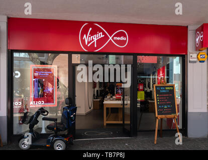 Swindon, United Kingdom - May 04 2019:   The Frontage of Virgin Media Store on the Parade - Stock Photo