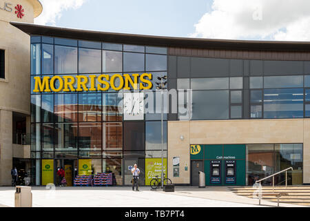 Swindon, United Kingdom - May 04 2019:   The entrance to Morrisons Supermarket at Regent Circus - Stock Photo