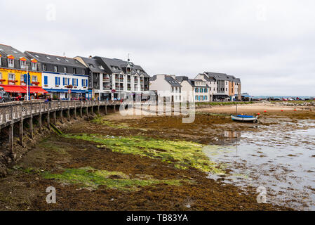 Camaret-sur-Mer, France - August 4, 2018: Scenic view of the port and waterfront at low tide - Stock Photo