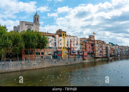 Girona, Spain - Sept 24 2018: View of Girona Cathedral, birds on the water and multi colored houses from bridge on the Onyar River, Girona, Spain - Stock Photo