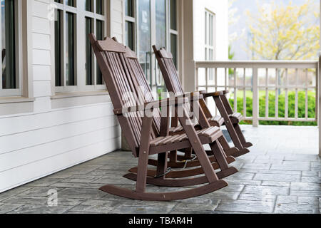 Traditional Wooden Rocking Chairs In Front Of Blue Walls