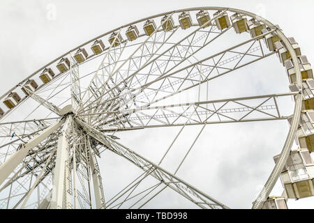 Famous ferris wheel Sziget Eye in Budapest over the grey sky backgound - Stock Photo