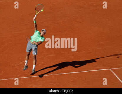 Paris, France. 1st June, 2019. Antoine Hoang of France serves during the men's singles third round match with Gael Monfils of France at French Open tennis tournament 2019 at Roland Garros, in Paris, France, on June 1, 2019. Credit: Han Yan/Xinhua/Alamy Live News - Stock Photo