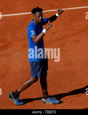 Paris, France. 1st June, 2019. Gael Monfils of France celebrates after the men's singles third round match with Antoine Hoang of France at French Open tennis tournament 2019 at Roland Garros, in Paris, France, on June 1, 2019. Credit: Han Yan/Xinhua/Alamy Live News - Stock Photo