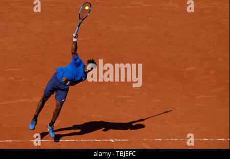 Paris, France. 1st June, 2019. Gael Monfils of France serves during the men's singles third round match with Antoine Hoang of France at French Open tennis tournament 2019 at Roland Garros, in Paris, France, on June 1, 2019. Credit: Han Yan/Xinhua/Alamy Live News - Stock Photo