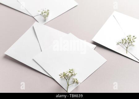 Mockups of invitations on grey background - Stock Photo