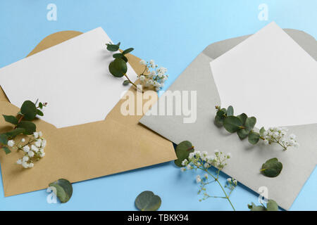 Mockups of invitations on color background - Stock Photo