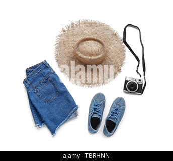 Set of female clothes, accessories and photo camera on white background - Stock Photo